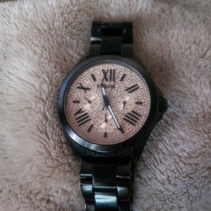 Rose gold and black Fossil watch